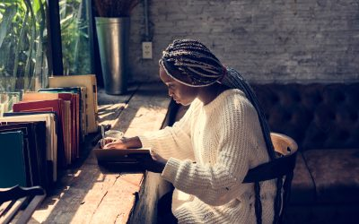 Photo of woman writing for article launching discoveries programme