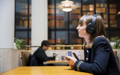 Photo of woman using headphones for Royal National Institute of Blind People article