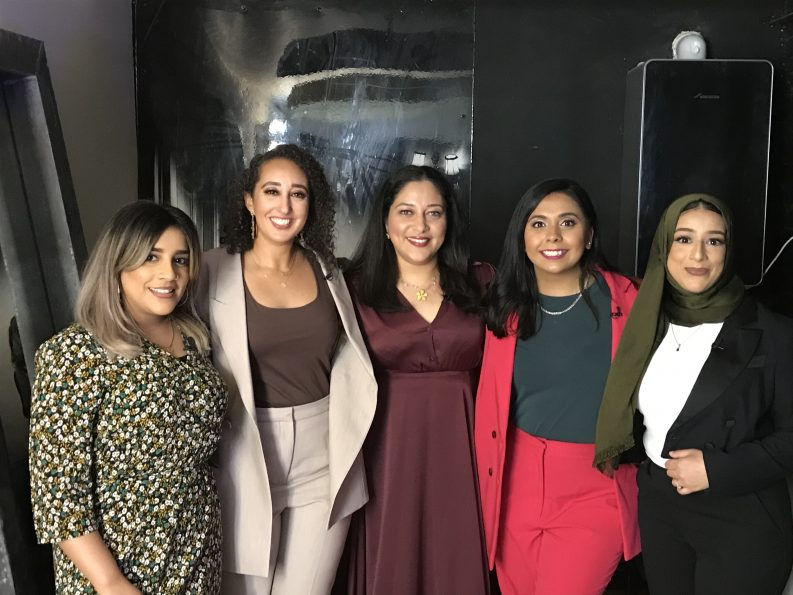 Photo of a group of smiling women